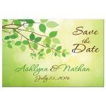 Spring green, yellow, and brown wedding save the date post card with green leaves and branches