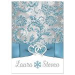 Winter wonderland wedding invitation in ice blue, silver, and white snowflakes