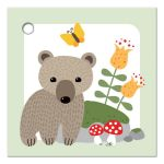 Cute brown bear cub in front of mossy rock, gift or favor tag.