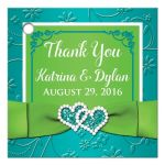 Custom turquoise blue, lime green and white wedding favor tag with faux embossed assorted flowers on it and a PRINTED lime green ribbon and bow with a pair of diamond jewels and FAUX glitter joined hearts on it.
