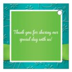 Personalized turquoise blue, lime green and white wedding favor tag with faux embossed assorted flowers on it and a PRINTED lime green ribbon and bow with a pair of diamond jewels and FAUX glitter joined hearts on it.