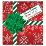 Great personalized Christmas beverage label or sticker in green, red and white snowflakes with striped ribbon, bow and gift tag with customized Season's Greetings on it.