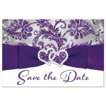 ​Best winter wonderland wedding save the date post card in ice purple, silver, and white snowflakes with ribbon and joined jewel and glitter hearts.