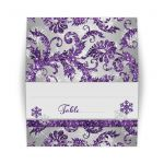 Great tented style ice purple, silver gray floral FAUX glitter floral damask pattern wedding place card or escort card with white snowflakes.