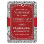 Black and silver floral wedding enclosure card with red ribbon, scrolls, glittery crystals, and joined jeweled hearts on it.