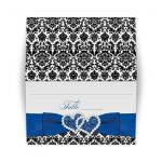 Great royal blue, black, and white damask wedding reception place cards with ribbon, bow and jeweled joined glitter hearts on it.