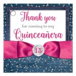 Great blue denim and diamonds Quinceanera party favor gift tag with silver glitter confetti, hot fuchsia pink ribbon and bow, decorative tiara, and a round faux diamonds and silver buckle brooch with 15 on it.