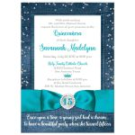 Great blue denim and diamonds Quinceanera invitation with silver glitter confetti, teal blue ribbon and bow, decorative tiara, and a round faux diamonds and silver buckle brooch with 15 on it.