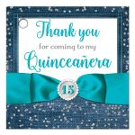 Great blue denim and diamonds Quinceanera party favor gift tags with silver glitter confetti, teal blue ribbon and bow, decorative tiara, and a round faux diamonds and silver buckle brooch with 15 on it.