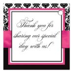 Personalized pink, black, and white damask pattern wedding favor tags with ribbon, bow, scroll, and jeweled joined hearts buckle brooch.