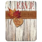 Fall in Love wedding response enclosure cards with fall leaves, burlap, wood grain, cardboard heart and orange bow.
