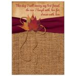 Burlap wedding invitations with a wine ribbon, a golden twine bow, and autumn leaves.