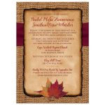 ​Rustic burlap wedding invites with a burgundy ribbon, twine bow, and burnt orange, red and rust fall leaves on it.