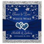 "​Personalized ""Cheers to Love!"" navy blue and silver wedding wine or beverage labels with double joined jewel hearts, ribbon and grey flowers."