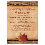 Rustic burlap autumn wedding accommodations enclosure card with a burgundy colored ribbon, a gold tone twine bow, and burnt orange, red, and rust autumn leaves on it.