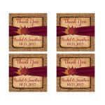 "​Personalized 2"" square rustic burlap wedding favor stickers with a burgundy colored ribbon, and burnt orange, red, rust, yellow, and gold autumn leaves on them."