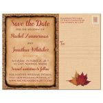 Rustic brown burlap wedding save the date postcard with a burgundy wine colored ribbon, a gold tone twine bow, and burnt orange, red, and rust autumn leaves on it.