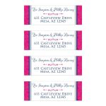 Personalized wedding address mailing labels in royal blue, hot pink, and white have a faux embossed floral pattern on both sides with a hot pink decorative scroll.