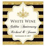 Black, Ivory and gold foil striped 50th wedding anniversary or wedding wine bottle or beverage bottle label with formal gold chandelier.