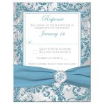 ​Winter wonderland wedding RSVP reply response enclosure card insert in ice blue, silver, and white snowflakes with ribbon and crystal buckle.