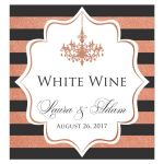 Personalized charcoal grey, white and copper foil striped wedding wine bottle label or beverage label with a formal ballroom chandelier has customizable wording and the names of the bride and groom and their wedding date.