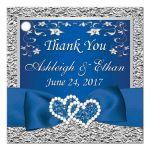 personalized royal blue and silver grey floral wedding favor tag with joined jewel hearts, ribbon, and bow.