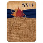​Rustic brown burlap wedding RSVP reply response enclosure card with a navy blue ribbon, a twine bow, and burnt orange, red and rust autumn leaves on it.
