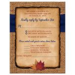 ​Rustic brown burlap wedding RSVP enclosure card with a navy blue ribbon, a twine bow, and burnt orange, red and rust autumn leaves on it.