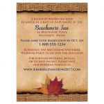 ​Rustic brown burlap wedding accommodations enclosure card insert with a navy blue ribbon, a twine bow, and burnt orange, red and rust autumn leaves on it.