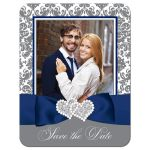 Navy blue, white and grey damask pattern wedding photo save the date card with ribbon, bow, jewels, glitter and ornate scroll.