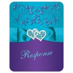 Purple and teal blue floral wedding rsvp card with turquoise aqua ribbon, bow, jeweled joined hearts, ornate scrolls and flourish.
