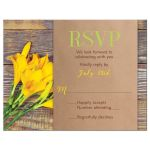 Yellow lily flower on rustic wood wedding RSVP card front