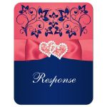 Coral pink, white and navy blue floral wedding RSVP enclosure card insert with joined jewel and glitter hearts buckle, ribbon and ornate scrolls.