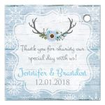 Personalized rustic blue and white snowflakes winter wedding favor tags with blue flowers, gray deer antlers, grey lantern, and blue wood.