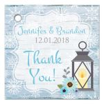 Personalized rustic blue and white snowflakes winter wedding favor tag with blue flowers, gray deer antlers, grey lantern, and blue wood.