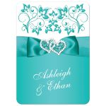 Turquoise or teal and white floral wedding invitation with joined jewel and glitter hearts brooch, ribbon and ornate scroll.