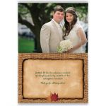 Personalized rustic burlap photo template wedding thank you card with a hunter green ribbon, a golden twine bow, and burnt orange, red, and rust autumn leaves on it.