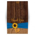 ​Rustic burlap and wood sunflower fall in love wedding thank you card with a cobalt or french blue ribbon, a twine bow, and a wood heart on it.