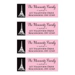 Pink, black, and white personalized return address mailing labels with a white illustration of the Eiffel Tower in Paris on them.