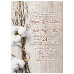 ​Trendy rustic cotton wedding invitation with twigs wrapped in ribbon and woodgrain wood background front