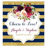 Navy blue, gold, burgundy wine, white striped Cheers to Love wedding wine bottle or beverage bottle labels with watercolor flowers and garland.