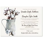 ​Rustic brown and white cotton stems and branches in water colored tin water pitcher with brown wood and photo template.