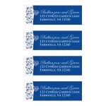 Royal blue and white floral wedding return address mailing labels with silver heart brooch, ribbon, and flowers.