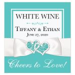 Personalized Tiffany Blue and White Wedding Wine Label, Bottle Beverage Label, or wedding favor sticker with PRINTED ON Ribbon, Bow, Jewel and Glitter Joined Hearts, and customizable message.