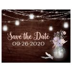 Best rustic wedding save the date postcard with brown wood, mason jars, string lights and purple, pink, blue, peach and green flowers, foliage, and feathers for a barn or country wedding.