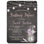 Rustic grey wood, mason jars and string lights sweet sixteen birthday party invitation with purple, pink, blue, peach and green flowers, foliage, and feathers.