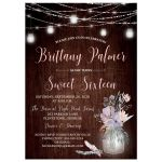 Rustic brown wood, mason jars and string lights sweet 16 birthday party invite with purple, pink, blue, peach and green flowers, foliage, and feathers.