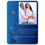​Modern white and blue photo wedding invitation with navy blue and royal blue flowers and silver butterflies on it.