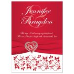 Red and white floral wedding invitation with silver heart brooch, ribbon, flowers, and ornate scrolls.
