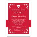Red and white floral wedding invite with silver heart brooch, ribbon, flowers, and ornate scrolls.
